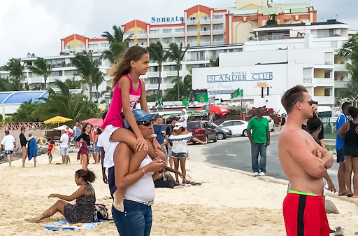maho-beach-young-girl.jpg - A young girl watching a plane take off at Maho Beach.