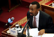 Ethiopia's Prime Minister Abiy Ahmed addresses the members of parliament inside the House of Peoples' Representatives in Addis Ababa, Ethiopia.