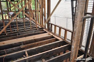 Photo: New 2x6 perimeter plywood subfloor diaphragm blocks.