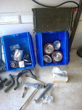 Photo: spare radiator, rally lights, starter, alternator, cap/rotor/wires, fuel pump-pre filter, oil filter, alt belt, coils and ignitors.