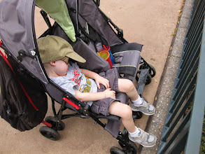 Photo: Day 3- Richard Josiah was not as captivated by world showcase as brother. He decided to take a good nap through it, even through the drums and flag corps show in Italy. Thankfully he woke up in time to see an amazing juggler at a street show :-)