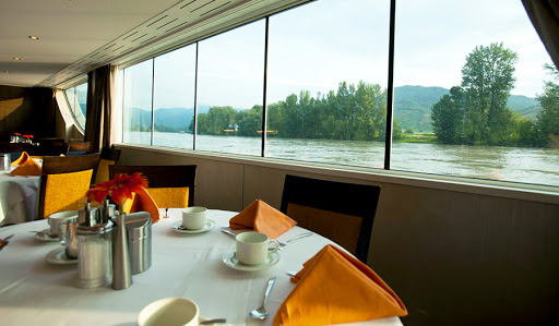 Dine while watching Europe sail by on Avalon Luminary.