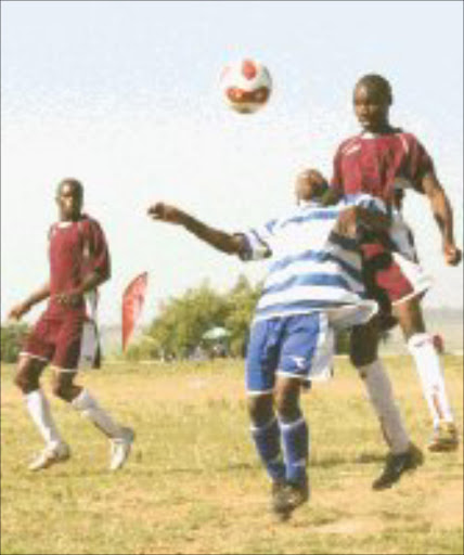 MARKED: Schoemansdal Junior Aces' General Shongwe, blue and white strip, and Driekopies Stars' Mzwakhe Zulu tussle for the ball during thier Selati Super Cup tournament at KaMhlushwa in Mpumalanga at the weekend. Pic. Andrew Hlongwane. 13/05/2007. © Sowetan.