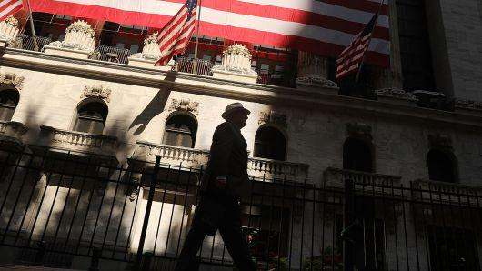 A man walks by the New York Stock Exchange in New York City.