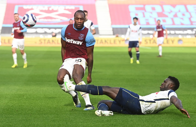 Michail Antonio of West Ham United is challenged by Davinson Sanchez of Tottenham Hotspur at London Stadium in London, England, February 21 2021. Picture: NEIL HALL/GETTY IMAGES