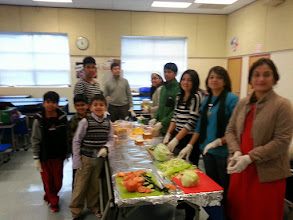 Photo: Parents and Youth preparing fresh sandwich meals for homeless