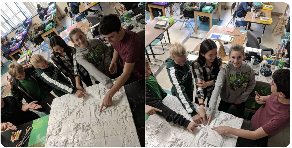 students standing next to the topographical maps that they created of Batavia.