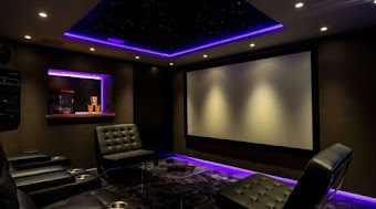 a home cinema with purple lighting