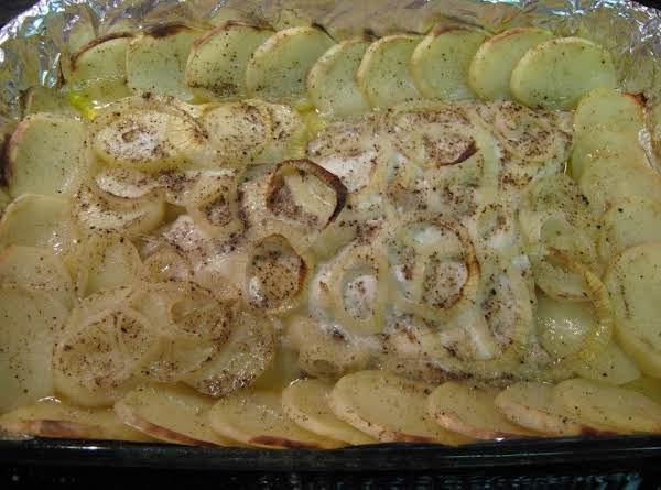 Down East Style Baked Flounder With Potatoes And Onions.