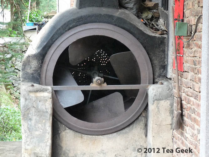 Photo: This tea dryer was set into the exterior wall of a house we walked by--basically tea processing equipment installed on the front porch. #tea #tieguanyin