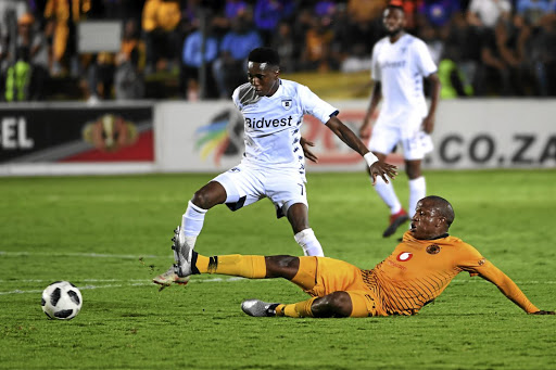 Elias Pelembe of Bidvest Wits and Lebogang Manyama of Kaizer Chiefs during a league match. / Lee Warren / Gallo Images