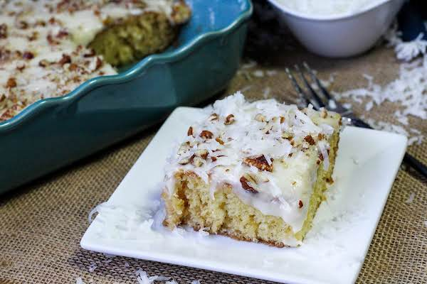 A Slice Of The Original Easiest Pineapple Cake With Gooey Frosting.