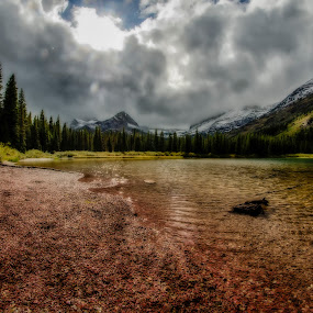Colors and Light by Sarthak Bisaria - Landscapes Mountains & Hills ( clouds, mountains, fisheye, trees, lake, rocks, glacier national park, grinnell lake )