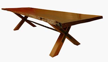 Photo: http://dorsetcustomfurniture.blogspot.com/2010/10/new-claro-slab-table-is-finished.html