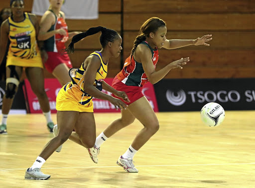 Siphosethu Kilani of the Aloes wards off a challenge by Sanele Buthelezi of the Sunbirds during the Brutal Fruit Netball Premier League match at Rembrandt Hall yesterday.