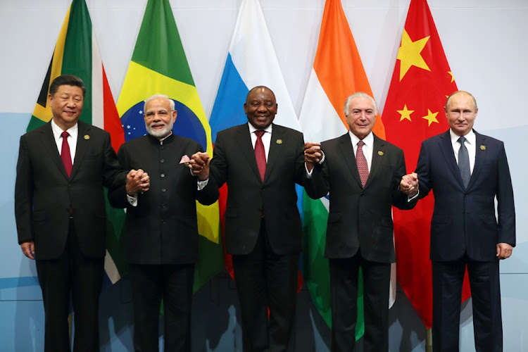 China's President Xi Jinping, Indian Prime Minister Narendra Modi, President Cyril Ramaphosa, Brazil's President Michel Temer and Russia's President Vladimir Putin pose for a group picture at the BRICS summit meeting in Sandton on July 26, 2018.
