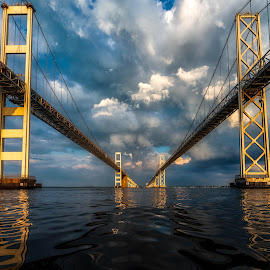 Storm is Coming by Carol Ward - Buildings & Architecture Bridges & Suspended Structures ( water, annapolis, chesapeake bay bridge, reflections, maryland, chesapeake bay, storm clouds, storm,  )