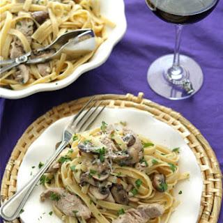 Pork, Mushrooms And Fettuccine In Garlic Wine Sauce.
