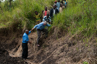 Photo: Rev. Dr. Tim Quill climbing down a hill to visit a Lutheran school in Papua New Guinea