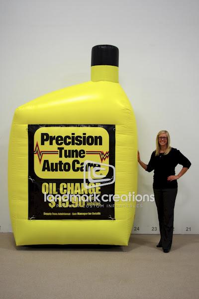 Photo: Precision Tune Auto Care uses giant oil bottle replicas outside auto service centers to promote oil change specials while reinforcing the Precision Tune brand.