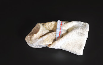 Photo: A24.	Chris	Thorson, 2014	 Sweat Sock (Red Stitching)	 1.5	x 5	x 3 in.	 Mixed media on hydrocal	 Retail Price: $450	 Buy It Now: $495 TO PURCHASE THIS WORK: call 415.863.7668 or email events@rootdivision.org AUCTION TICKETS are available at http://www.rootdivision.org/Auction2014.html