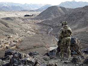 Photo: A Special Forces soldier observes a valley in Uruzgan as a Blackhawk circles above. Mid: Afghan National Police and their Australian Special Forces partners have further degraded the insurgent networks operating in central Uruzgan by capturing three key leaders in separate missions. Members of the Provincial Response Company Uruzgan (PRC-U) and the Special Operations Task Group (SOTG) detained the objectives in Deh Rafshan and Baluchi during targeting operations in May. Deep: The Special Operations Task Group is deployed to southern Afghanistan to conduct population-centric, security and counter network operations. SOTG support the Afghan National Police's Provincial Response Company in Uruzgan and northern Kandahar. SOTG includes members from the Special Air Service Regiment (SASR), 1st and 2nd Commando Regiments, the Incident Response Regiment, Special Operations Logistic Squadron and supporting units.