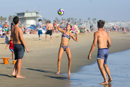 A group of visitors from Italy play soccer (futbol) on Venice Beach in the city of Los Angeles.