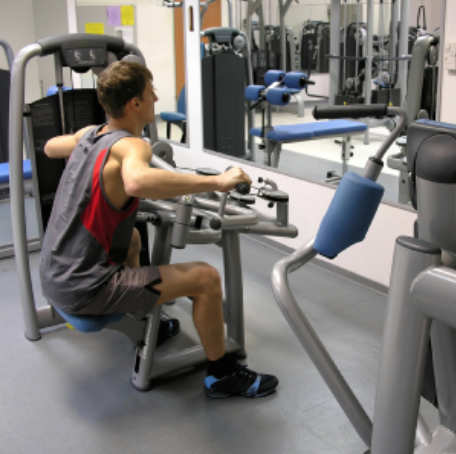 Teenager in the gym on a resistance machine