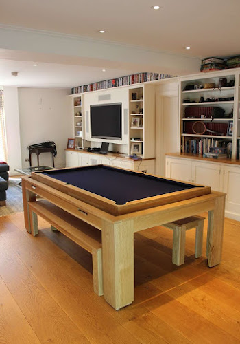 the light wooden spartan pool table on a wooden floor in a lounge area