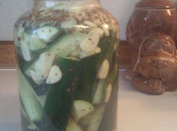 Pour mixture over pickles into jar, cover and fridgerate for 5 days