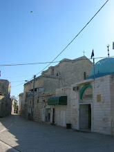 Photo: exterior of the church of St. George, a mosque is adjacent as the Muslims also venerate St. George