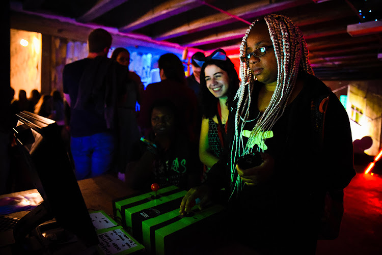 Sithe Ncube from Zambia plays one of the featured games on display at the A MAZE festival last year.