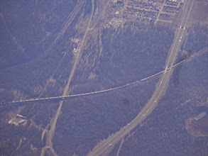 Photo: A train passing east of Williams. That's Rt 66 on the left, and I-40 on the right.