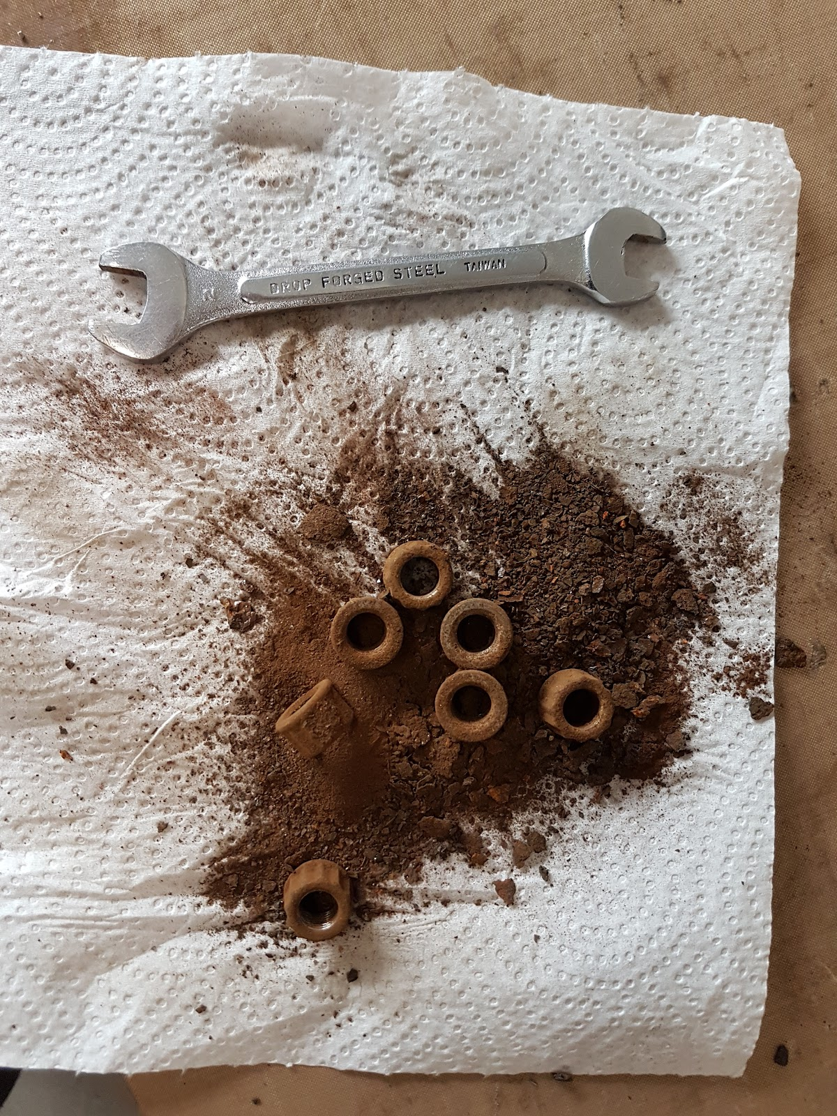 What came out of the T140's fuel tank after the nut rattling rust remover technique.