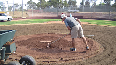 Photo: Getting ready to re-build the mound. Scrape conditioner off 1st, wet and let soak 2nd, scar up surface, and then bring in pre-moistened freshly screened clay.