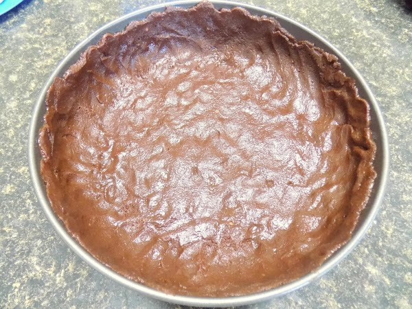 Crust: melt butter and add to cake mix. Mix well and press into springform...