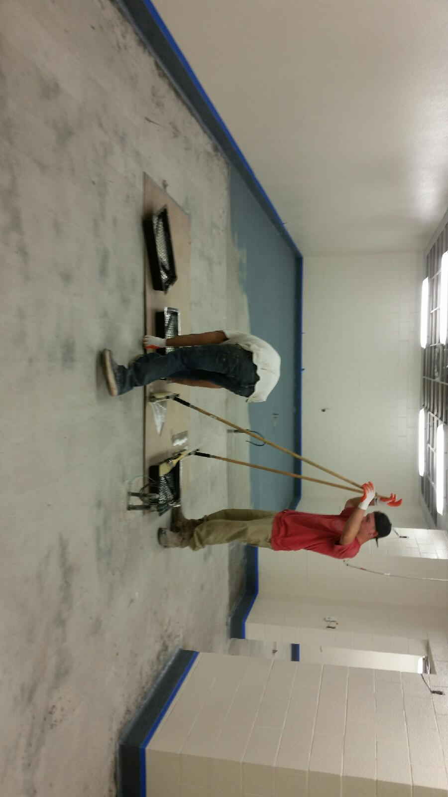 A picture installing an epoxy floor in a commercial kitchen