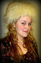 Photo: <KAPELUXE> Unique-Chique Hats by Luba Bilash ART & ADORNMENT  Ivory wool felt base, Mongolian lamb, 360 degree possibilities. Can also be worn on an angle. Size L - 56 cm/22 in $85 SOLD