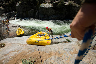 Photo: Guides lower boats into the river before whitewater rafting on the Stanislaus River, CA.
