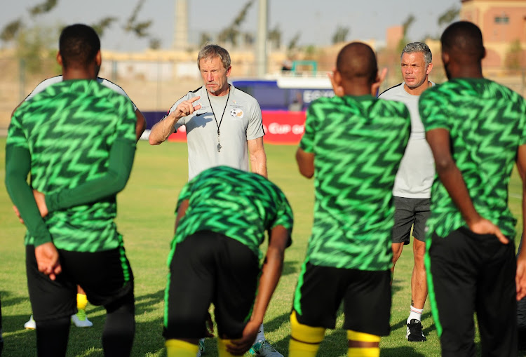 Stuart Baxter and Mark Fish during a team talk before training in Cairo on July 7 2019.