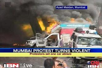 Photo: Mumbai: Protest against Assam riots turns violent http://t.in.com/2q71