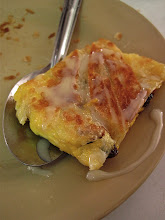 Photo: a bite of egg roti dribbled with condensed milk