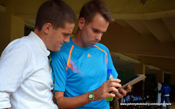 Photo: Coach McKinstry and Analyst Tom Legg reviewing Performa Sport analysis  [Leone Stars v Swaziland 31 May 2014 (Pic: Darren McKinstry)]