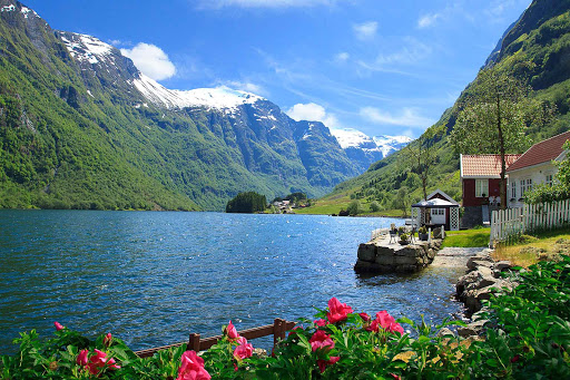 Norway-Naeroyfjord-cottage - A summer cottage on Naeroyfjord adds color to the verdant green Norwegian hills.