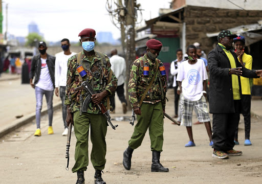 Police officers on the streets of Eastleigh, Nairobi, after a Covid-related protest residents of the Nairobi suburb protested restrictions on movement patrol the streets of Eastleigh during the demonstration.