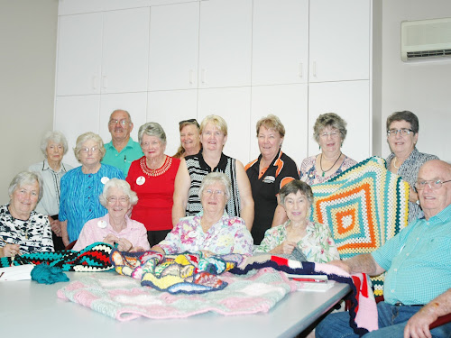 Narrabri Red Cross members at a meeting at the RSL yesterday, pictured with some of the rugs they have already made, standing, Ruth Rees, Ann Wall, vice-president Max Pringle, Dawn Armstrong, Helen Smith, Sheryl Skues, Robyn Faber, vice-president Pat Hardgrave, assistant secretary Diane Streeter, sitting, Robyn Wangmann, treasurer Bette Panton, president Kath Davis, secretary Jan Holmes and Harold Davis.