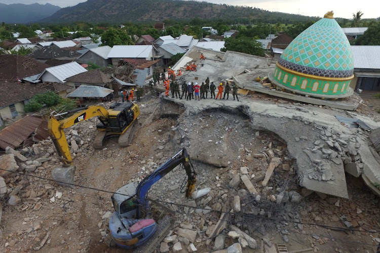 An aerial view of the collapsed Jamiul Jamaah mosque where rescue workers and soldiers search for earthquake victims in Pemenang, North Lombok, Indonesia August 8, 2018.