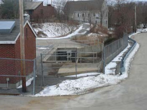 Photo: 'Spillway' weir in center of shot Original course of Town Brook  flows in from Fort Square in left upper background