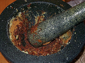 Photo: pounding spices and herbs for satay sauce