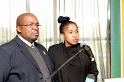 Cricket South Africa (CSA) president Chris Nenzani (L) and CSA company secretary and head of compliance Lindiwe Ndaziba (R) during the organisations' annual general meeting at OR Tambo International Airport's Inter-Continental Hotel on September 08, 2018 in Johannesburg, South Africa.